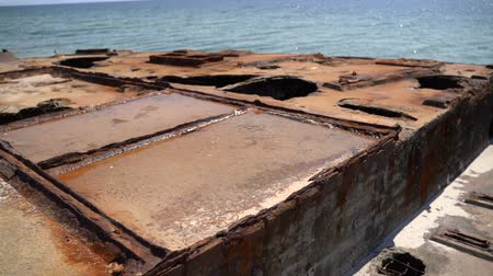 guarniciones : Old rusty reinforced concrete structure on the Black Sea. Slow motion