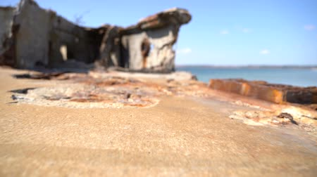 reinforced : Old rusty reinforced concrete structure on the Black Sea. Slow motion