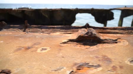 reinforced concrete : Old rusty reinforced concrete structure on the Black Sea. Slow motion