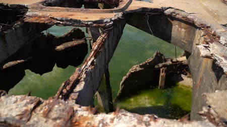 арматура : Old rusty reinforced concrete structure on the Black Sea. Slow motion
