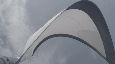 winch : White sail sways from the wind on a yacht. S-Log3 S-Gamut3 Cine. Slow motion