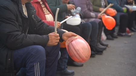 конфронтация : Workers baton with protective orange helmet for protests. Slow motion. Video with sound
