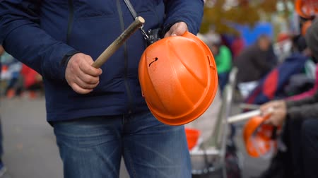 matraque : Workers baton with protective orange helmet for protests. Slow motion. Video with sound