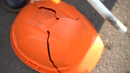 confronto : Workers baton with protective orange helmet for protests. Slow motion. Video with sound