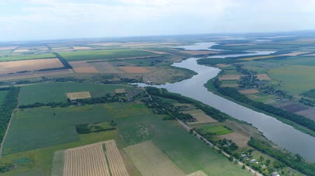 field survey : Flying over agricultural fields and river in summer. Aerial survey