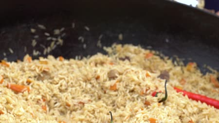 aluminium : Stir the prepared pilaf in a pan with a metal spoon