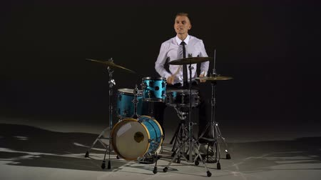 musician : The guy plays with chopsticks on the drums. General shot Stock Footage