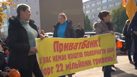 sztrájk : Dnipro, Ukraine - 11 October 2019: The strike of metal workers near the bank. Slow motion