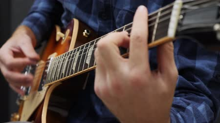 rocker : Male hands playing on guitar. Professional guitarist playing solo on electric guitar. Young man performing lyric song on music instrument. Guitar lessons