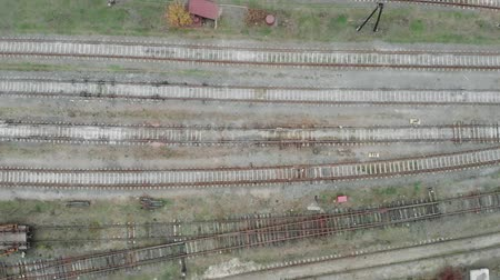 vagoneta : Aerial view of empty railway tacks in the industrial part of the city. Railwaystation without cargo wagons and trains Archivo de Video