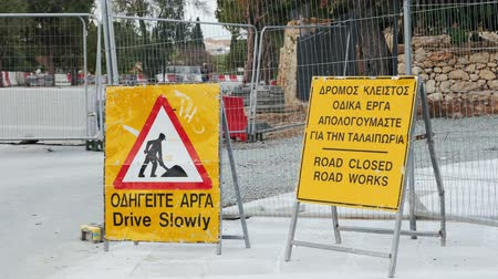 reflektor : Road closed Road works ahead Drive slowly yellow sign near street under construction. Road blocked ahead.