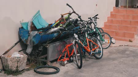 brake : Dump of old bicycles. Broken bikes lying in landfill. Old broken bicycles thrown into landfill. Old rusty bikes lying around. Rusty bikes wallowing in backyard of house