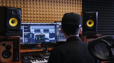 compressor : Home music studio. Sound engineer mixing and mastering at sound music studio. Digital audio workstation. Home recording studio. Stock Footage