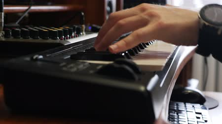compressor : Hands playing on piano electronic keyboard with digital watch. Music recording studio concept. Musician producing song in studio. Song recording process. Stock Footage