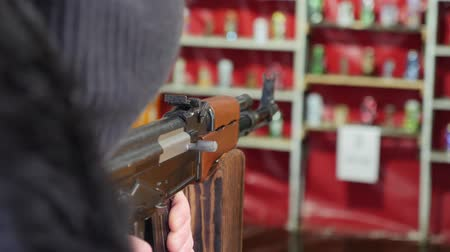 golyó : Shooter fires a gun at a target. Shooting gallery Stock mozgókép