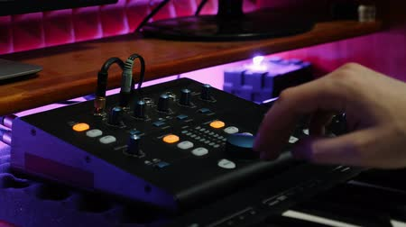 compresor : Musician mixing and creating music at digital audio workstation. Sound engineer working at home music studio with equalizer mixing gear. Male composer mastering at sound music studio