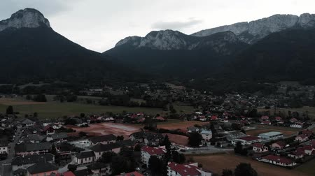snow on grass : French Alps from bird eye view. Aerial view of beautiful alpine mountains. Drone flying around mountain valley