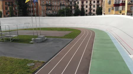 fixní : Aerial drone view of Kyiv Velodrome. Training at cycling track. Cycling concept Dostupné videozáznamy