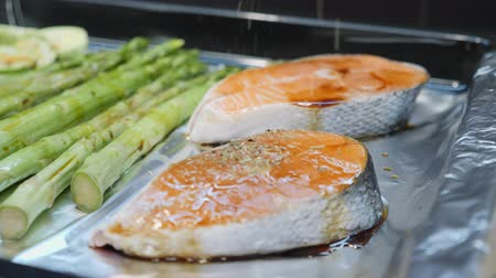 seafood recipe : Seasoning salmon with herbs and vinegar before putting in oven Stock Footage