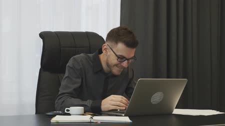 won : Man winning trade on stock market. Young trader won a trade at financial market. Businessman celebrating good news seen on laptop screen. Man excited with financial result of company. Victory concept Stock Footage