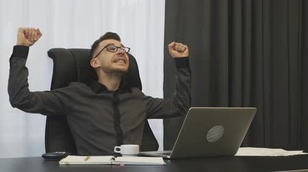 won : Trader won a trade on financial stock market. Successful businessman happy with financial result of company. Man celebrating winning deal with partners. Employee excited with successful job promotion Stock Footage