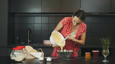 baking ingredient : Housewife preparing a pie in home modern kitchen. Woman pours dough into baking dish. Female cooking homemade sweet pie. Home cooking concept. Health and wellness lifestyle concept Stock Footage