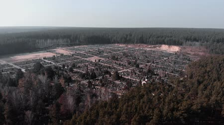buried : Drone flying above cemetery surrounded by forest. Aerial shot of graveyard. Top view of burial ground. Drone flies above local village cemetery. Stock Footage