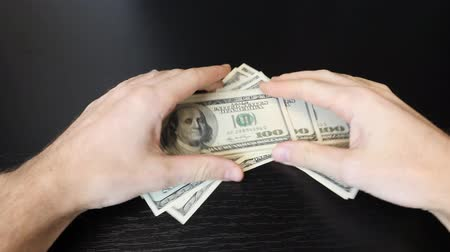 Close up of american one hundred dollar bills pile. Male hands holding money cash. Finance and money payment concept. Successful business concept