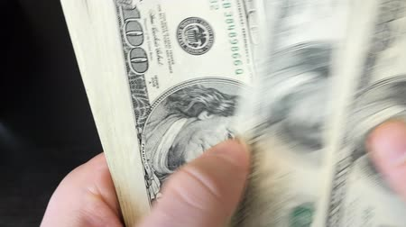 adósság : Extra close up of hands counting banknotes. Man count american dollar bills pile. Money in hands. Finance and money payment concept. American currency exchange in bank. Close up of american dollars