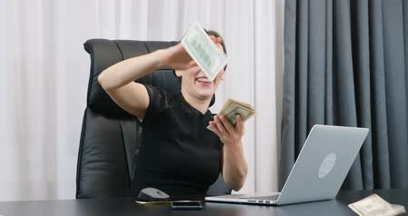 Woman scatters dollars. Spread the cash. Businesswoman scattering money. Rich woman with money. Lady boss throwing money. Finance and success business concept Стоковые видеозаписи