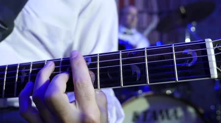 Close up of jazz guitarist on stage playing the electro-guitar with mediator Wideo