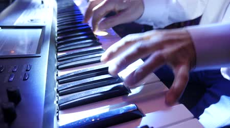 Musician playing keyboard. closeup