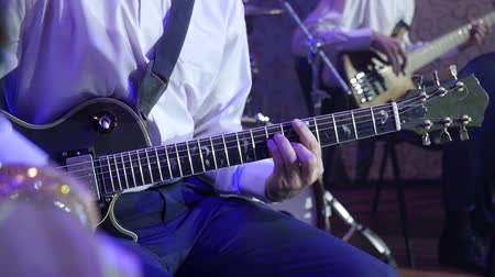 man plays the electric guitar in jazz orchestra