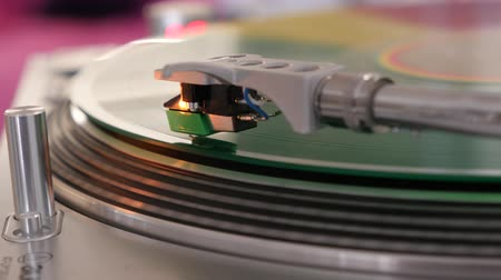 gramophone : colorful vinyl spinning on a record player close-up
