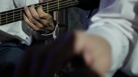 jazz festival : hands of musicians in white shirts playing a live concert Stock Footage