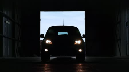 hangar : new car included Headlight. automatic start automobile. large. shut down main beam lights. Stock Footage