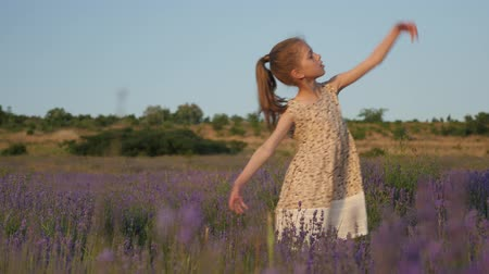 feeling emotion good mood. little girl dance. nature summer sun. plants and flowers lavender. happiness joy delight. art of dance