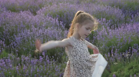 lifestyle art of dance. harmony nature. feeling holiday emotions. dance young kid girls. childhood holidays vacation. idyllic landscape countryside France. blossoming flower field summer season.
