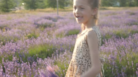 attractive little girl holiday in Provence. laughter and smiles feeling good, summer nature of Europe Wideo