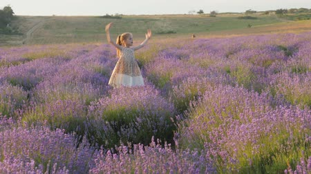 funny little girl joyfully get fleeing and happy jumping beautiful place outdoors countryside. During summer school vacations