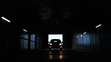 large-sized car silhouette with headlights. shut down main beam lights.lifestyle driver. concept shot industry Wideo