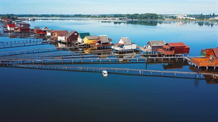 magyarország : Aerial panorama of traditional fishing houses line on the lake shore, Hungary.