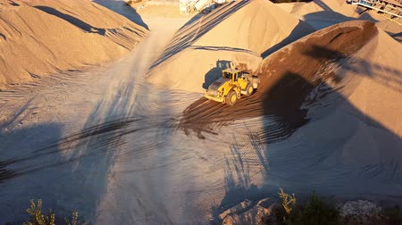 drone : Aerial view loading bulldozer in open air quarry Stock Footage