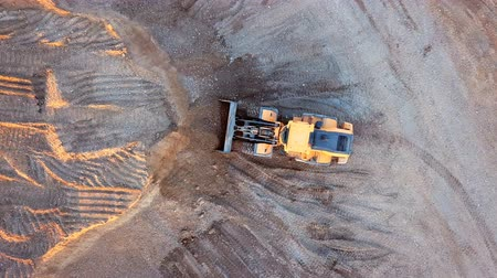 buldozer : Aerial view loading bulldozer in open air quarry Dostupné videozáznamy