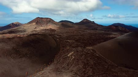 кратер : Flying over volcano near Timanfaya National Park, Lanzarote, Canary islands, Spain