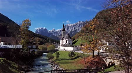 Бавария : Flight over famous Parish church St. Sebastian, in Ramsau, Berchtesgaden, Bavarian Alps, Germany