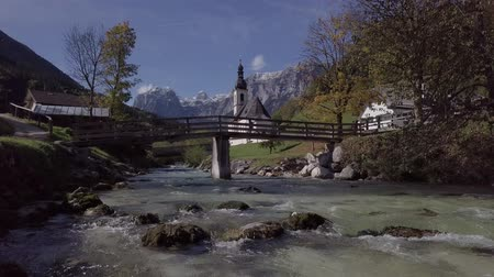 bávaro : View from river surface of famous Parish church St. Sebastian, in Ramsau, Berchtesgaden, Bavarian Alps, Germany. Original untouched LOG format.