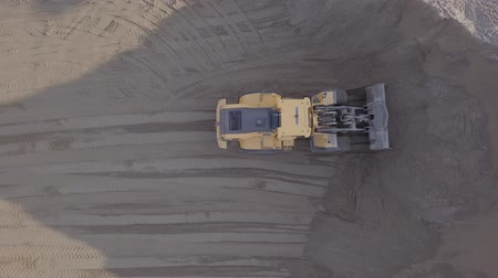 hydraulic : Aerial view loading bulldozer in open air quarry. Original untouched LOG format.
