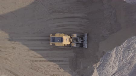 buldozer : Aerial view loading bulldozer in open air quarry. Original untouched LOG format.