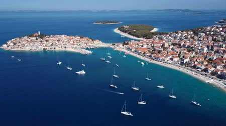 flying video : Aerial panorama of marina and resort adriatic town Primosten, Croatia.